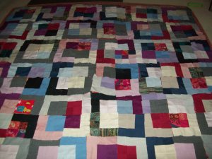 Almost done piecing my quilt made from my worn work clothes