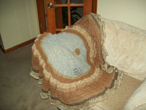 Crochet throw made from various colors of handspun cotton