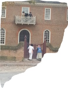 Two African American Reenactors  observing the recitation of the Declaration of Independence at colonial Williamsburg, Virginia.