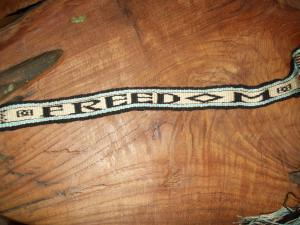 """While practicing double weave technique I was inspired to weave in the word """"Freedom"""" as I was determined to free myself from debt at that time."""
