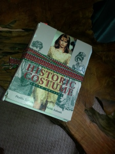 My textbook on Historic fashion is in pieces held together by an inkle band