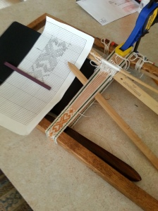 1st weaving sample. We use a picture frame as a loom!