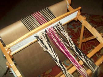 rolling on acrylic warp on Kromski Rigid Heddle Loom
