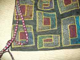 close-up of bag embroidery and new card-woven strap