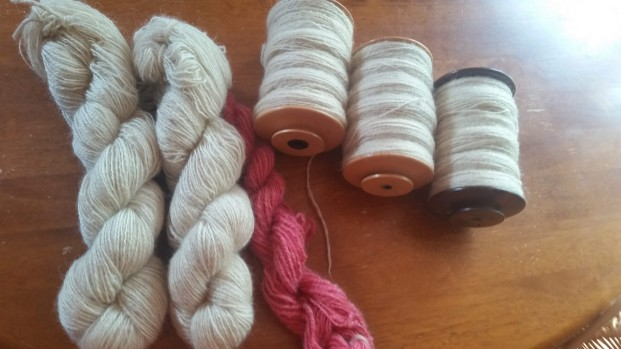 handspun combed Cotswold (the dyed skein is carded 2nds)